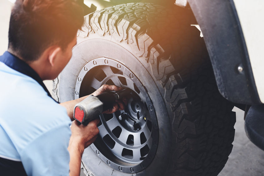 Rice Tire Repair or changing tire car pickup mechanic screwing unscrewing